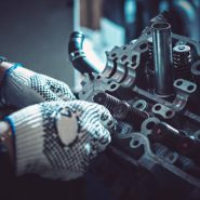 The auto mechanic deconstructs the internal combustion engine for diagnosis and repair. Closeup.